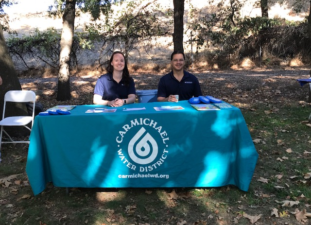 district employees at outreach booth