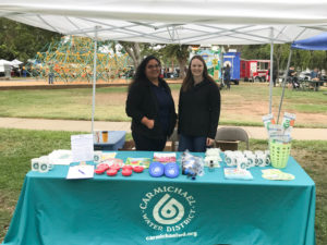 employees at founders day with booth